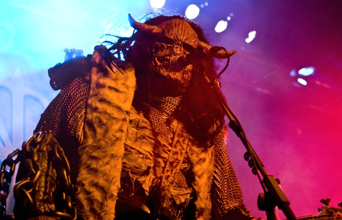 A masked member of Lordi wows the crowd at a concert.