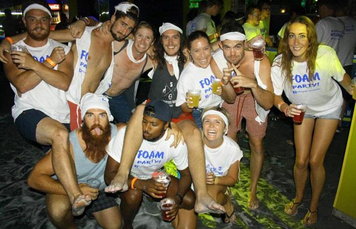 X Hostel friends at a foam party