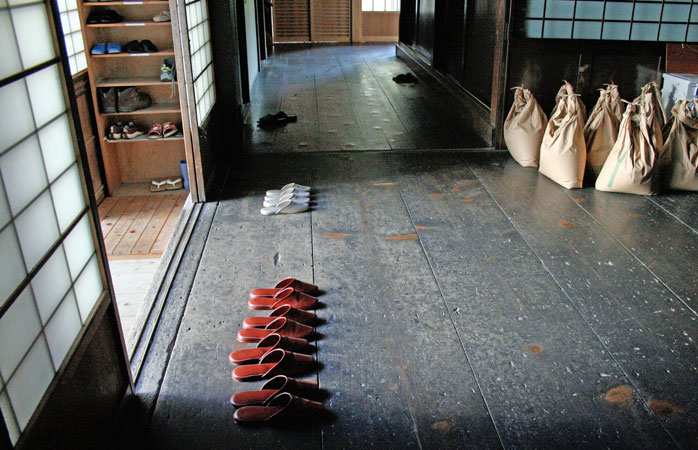 Shoes off, slippers on when entering a Japanese home or temple