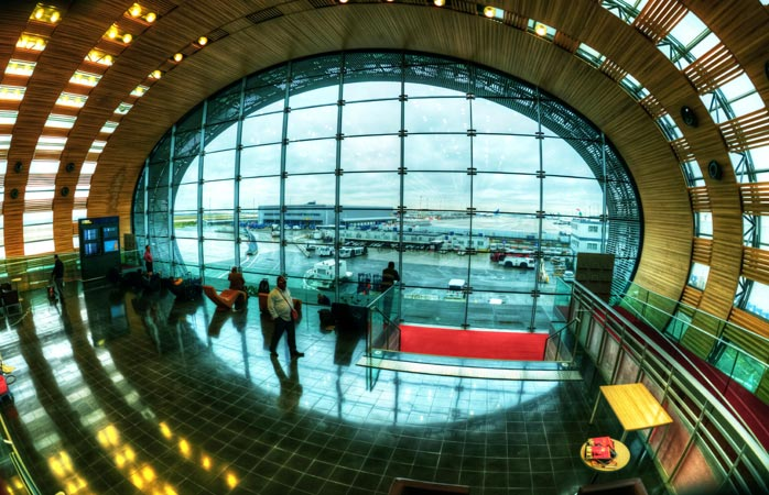 Travellers pass through the terminals of Paris's Charles de Gaulle airport