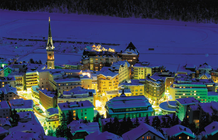 The lights of St. Moritz shimmering against the backdrop of the dark night