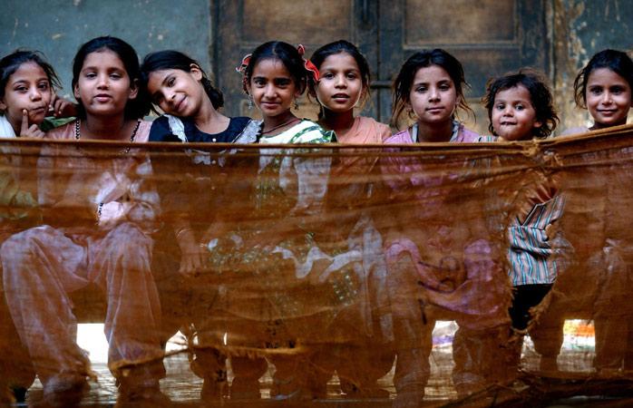 Muslim children sit inside the Dariya Khan Ghhumnat Rahat refugee camp set up outside a school in the state of Gujarat in Ahmedabad, India