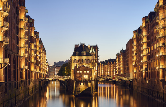 A canal view of the Poggenmühlenbrücke in the Speicherstadt