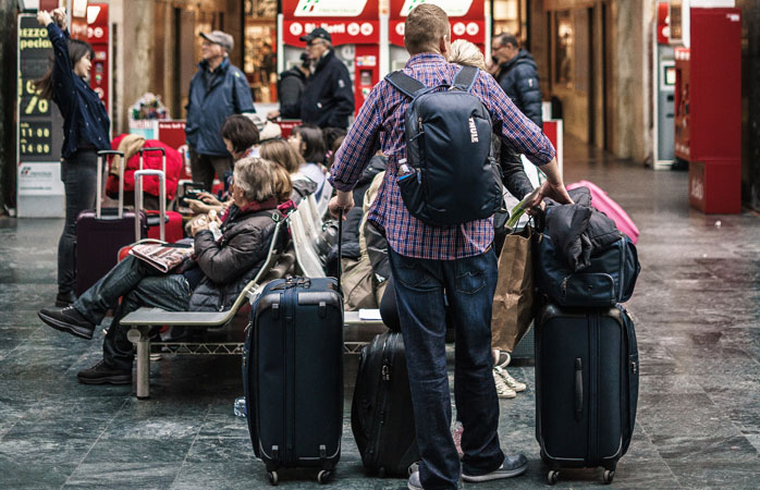Read the fine print when it comes to how much your checked and carry-on bags can weigh