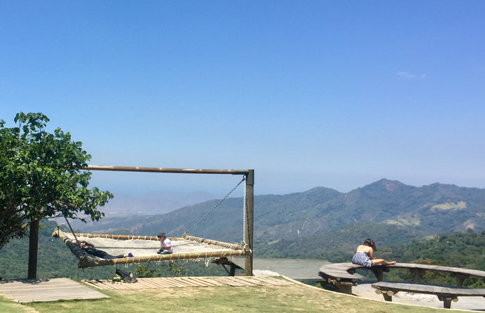 Slow down at Casa Elemento hostel, which has one of the world's largest hammocks with a view of the mountains